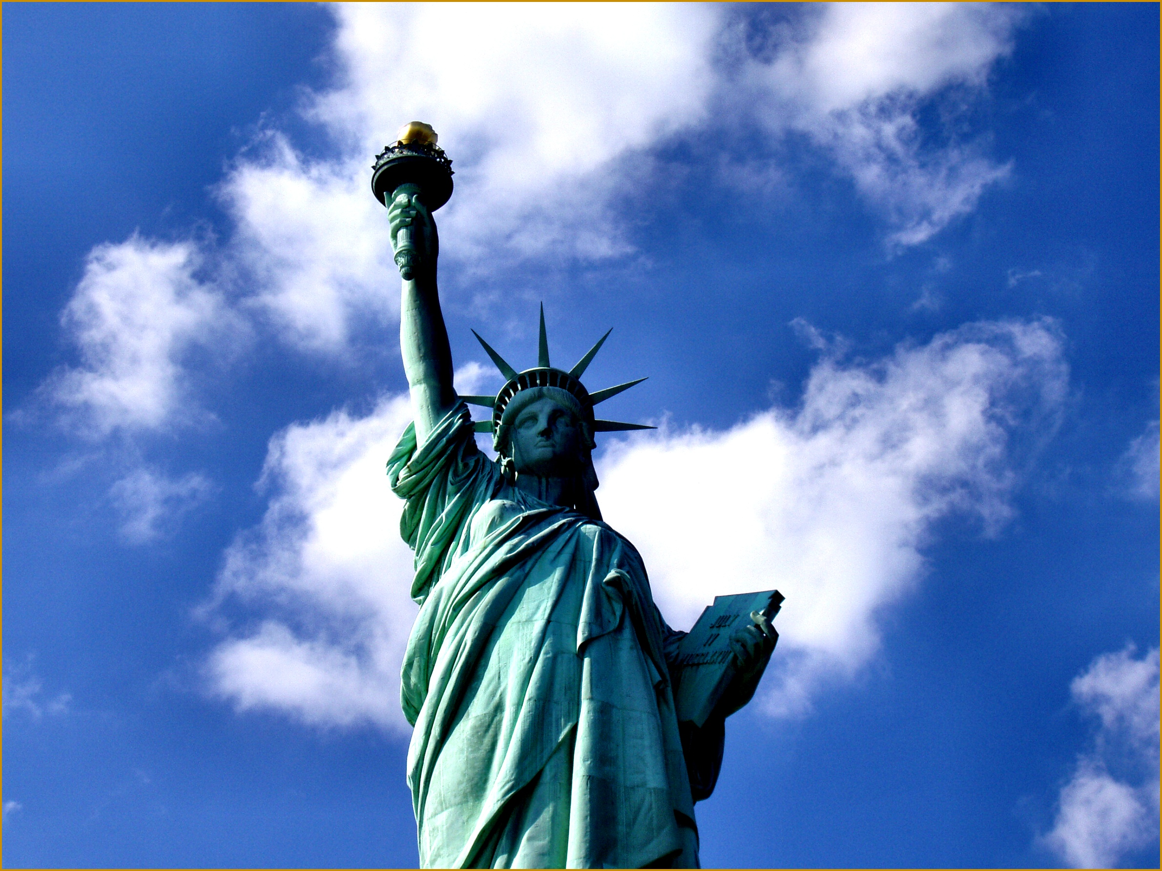 The Statue of Liberty in New York City dedicated in 1886 is a symbol of the United States as well as its ideals of freedom democracy and opportunity 23801785