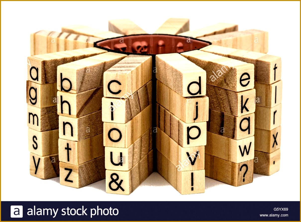 Letters of the English alphabet on the ends of wooden bars isolated on white background 8901209