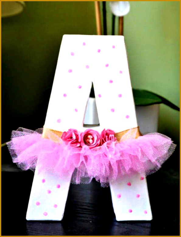 Wooden letter decorated with a tutu 777595